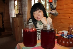 Traveler from Hong-Kong tasting home-made raspberry and chokeberry wine