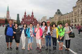 Travelers from China on Red Square with Oxana